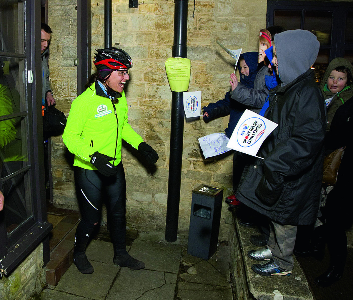 Davina McCall is greeted by cheering children at Killingworth Castle, Wootton, after she arrived for a stop during her Sport Relief challenge