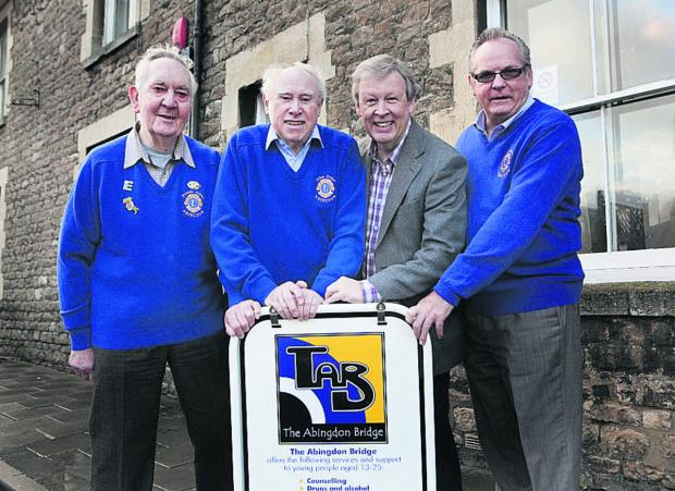 Chris Bryan, second right, chairman of the Abingdon Bridge charity, with, from left, Lions Club members Frank Allen, John Prior and Ron Skinner Picture: OX64803 Antony Moore