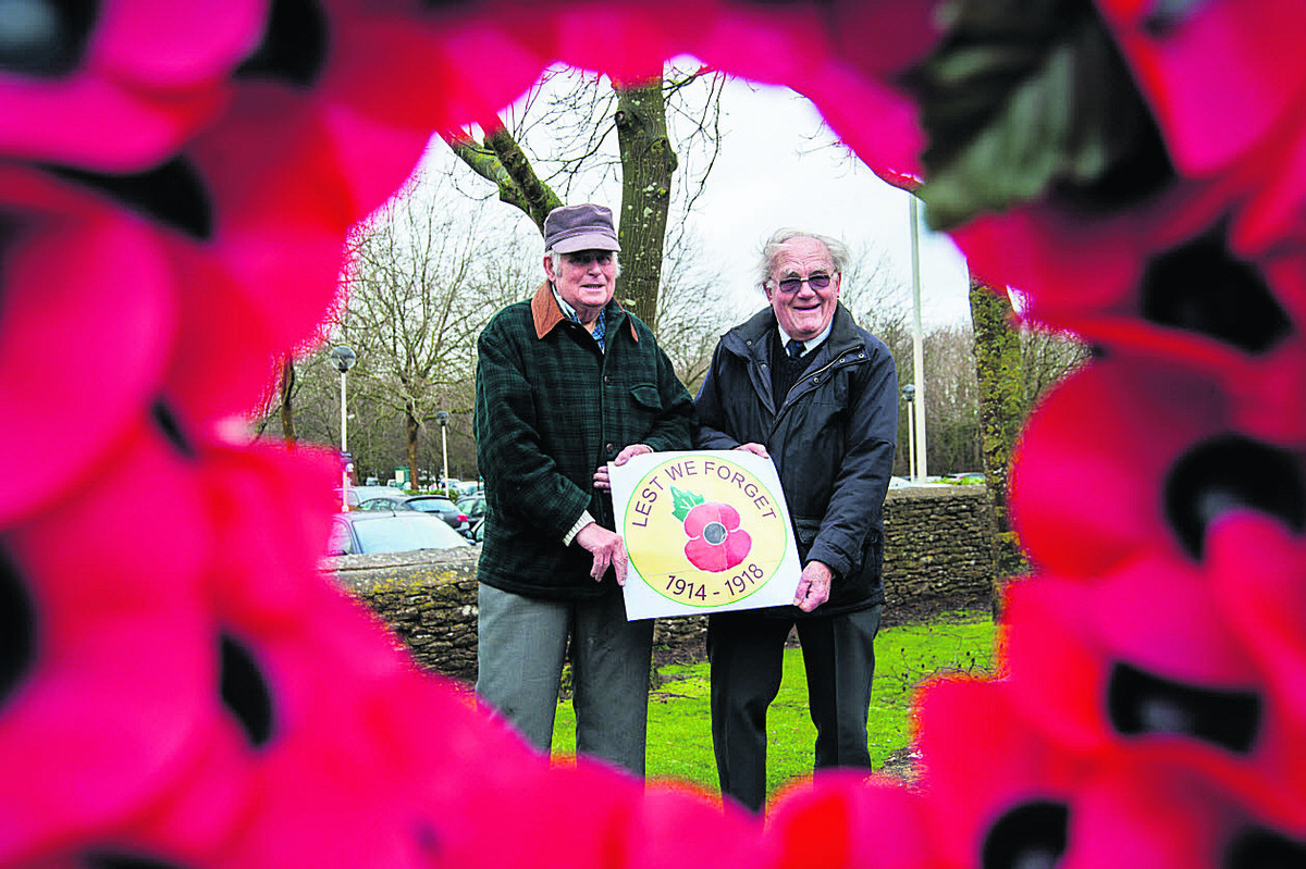 Les Tacon, left, and Don Deaney stand with the proposed plans for the next Witney in Bloom flower beds. Picture: OX65186 Aimee Kirkham
