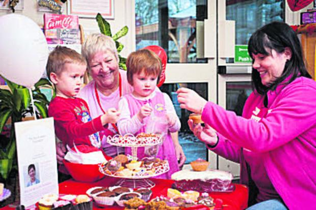 From left, Rowan Baker, four, nursery practitioner Heather Goodwin, four-year-old Frances Goodliffe and Vicky Ralph  of Breast Cancer Awareness. Picture: OX65291 Andrew Walmsley