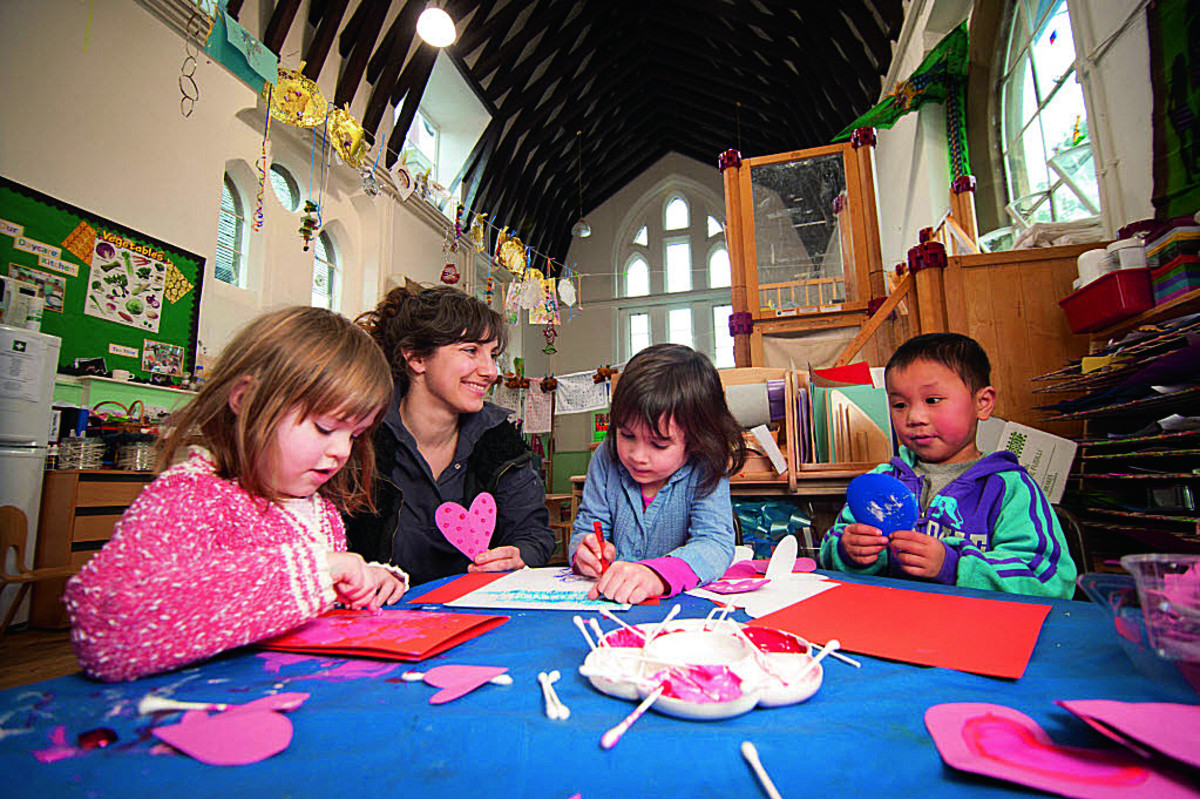 Getting creative to celebrate the school's birthday, from left, Kristina Sutton, aged three, teaching assistant Katie Wilson, Bea Parry, aged four, and Leon Huang aged three