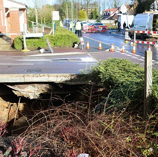 Sink hole prompts home evacuations