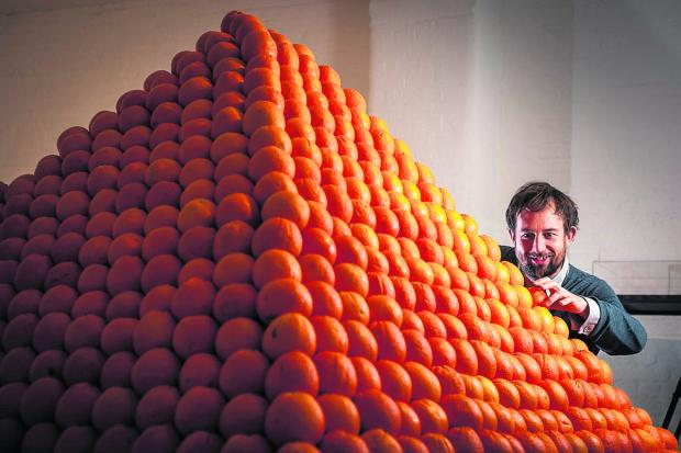 help YOURSELF: Curator Ben Roberts with Soul City (Pyramid of Oranges) by Artist Roelof Louw