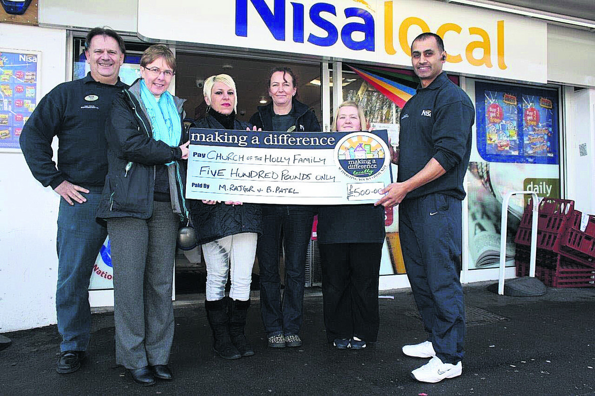 Paul Whitman, left, presents the cheque to the Rev Heather Carter, second left, with Kelly Emanuel, Cathy Cartwright, Kerry Bourke and Manoj Rajgor