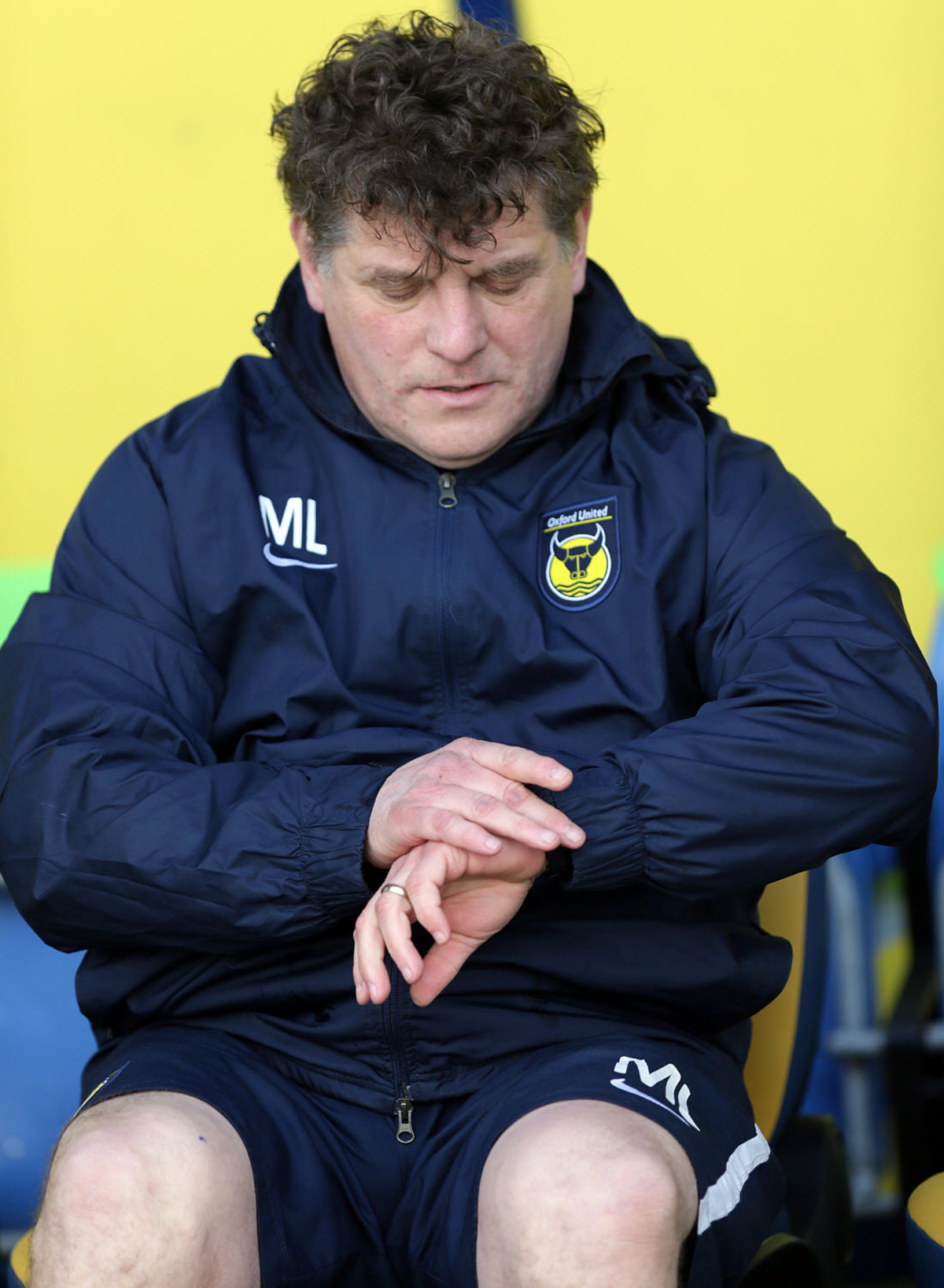 Caretaker boss Mickey Lewis checks the time during Saturday's 3-0 win over Mansfield, but he expects a harder test at Newport tonight