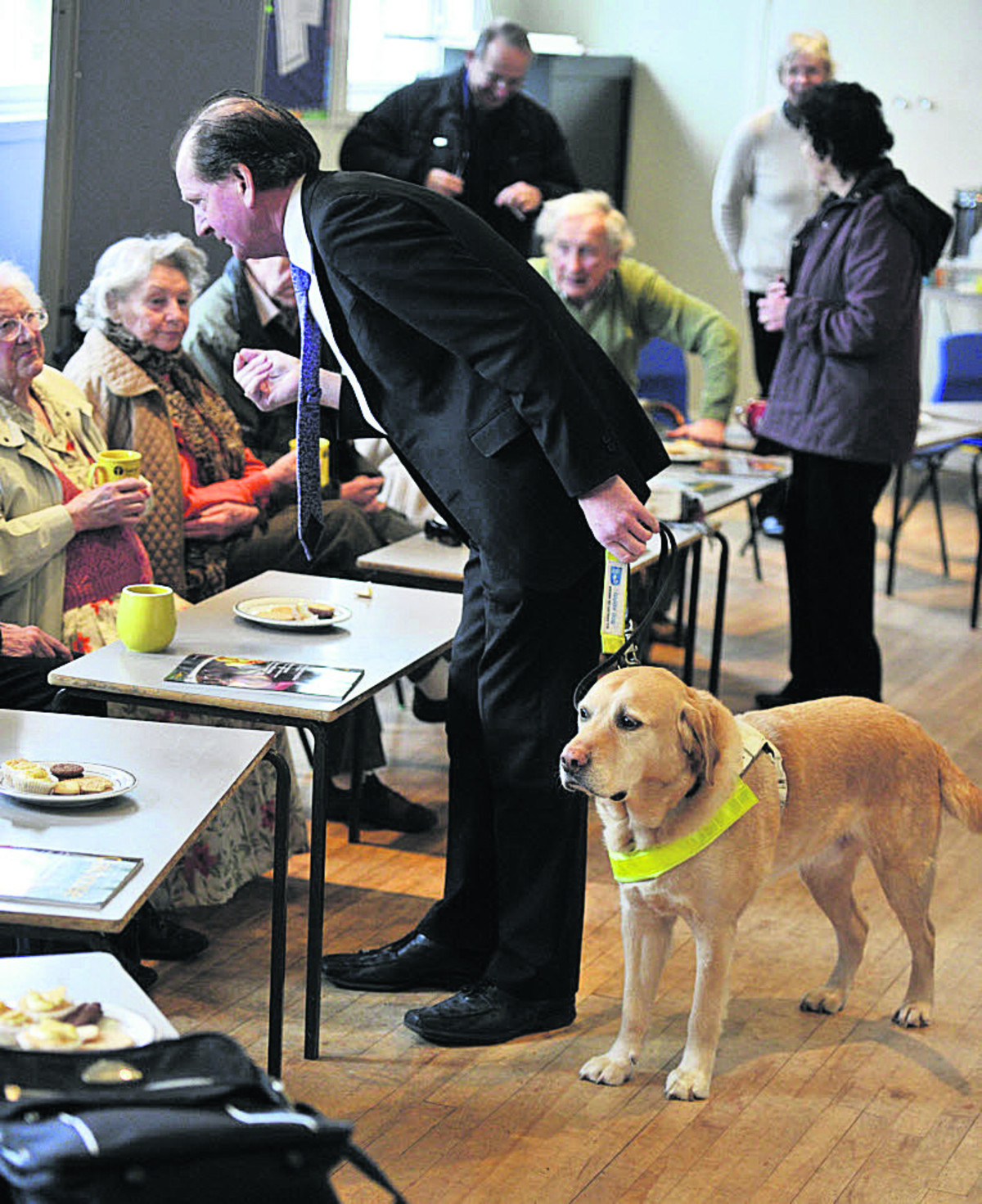 Tom McInulty and his guide dog Brunel at the group. Picture: OX65256 Mark Hemsworth