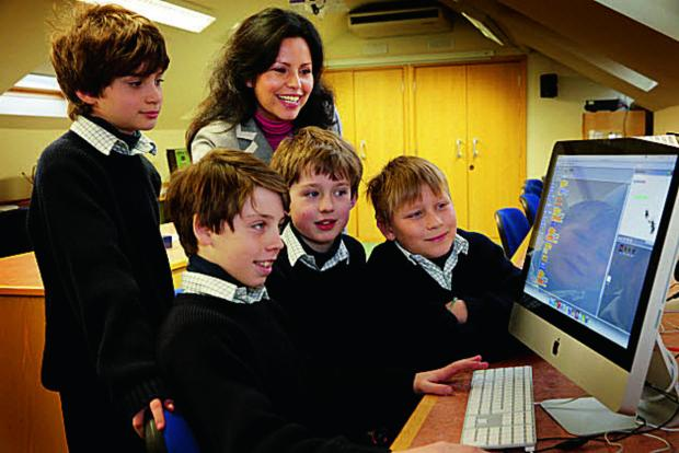 Deborah Trujillo-Philippopoulos, of ComputerXplorers with Cothill House School pupils, from left, Lucas Farleigh, 10, Alexander Huber, 10, Johnny Ekins, 10 and Marcus Jarvis, 10 Picture: OX65223 Damian Halliwell