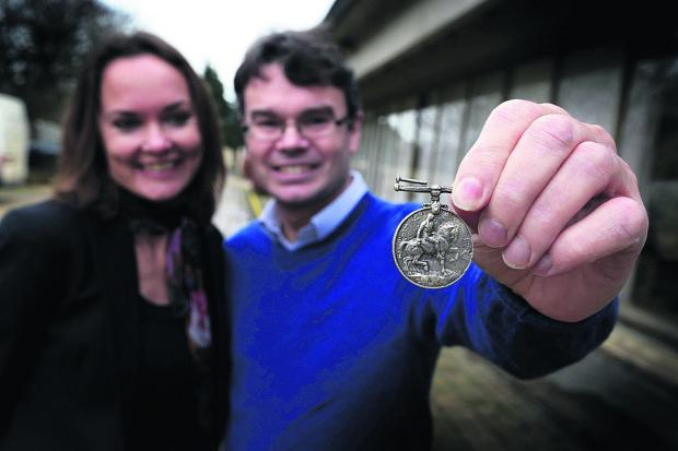 Sally Barton and Chris Nevin with the medal belonging to William Boor. Pictures: OX65183 Leah McLaren