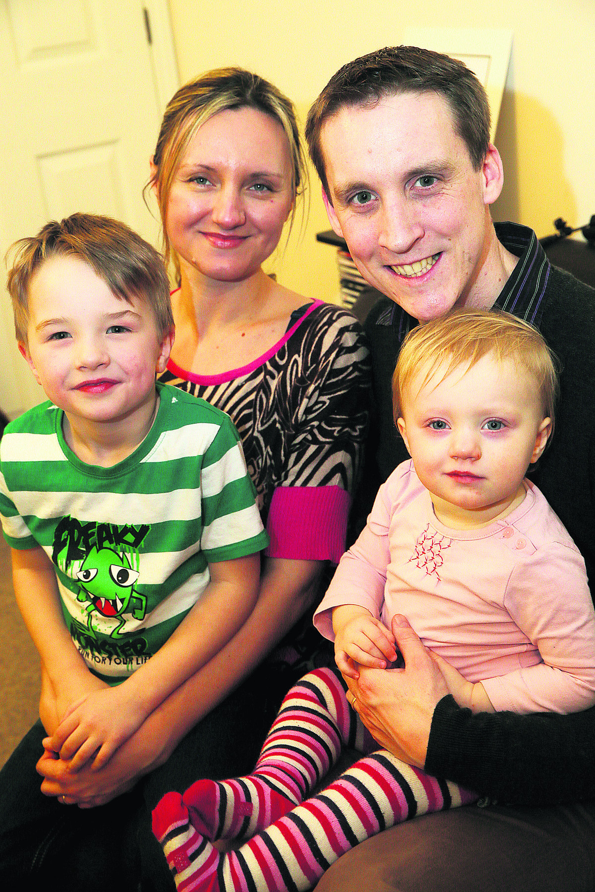 Karolina and Stephen Pilton with 18-month old Lena and son, Adam, four