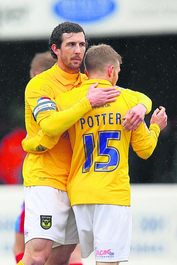 The Oxford Times: Jake Wright congratulates Alfie Potter's winner at Dagenham - which began United's run last April
