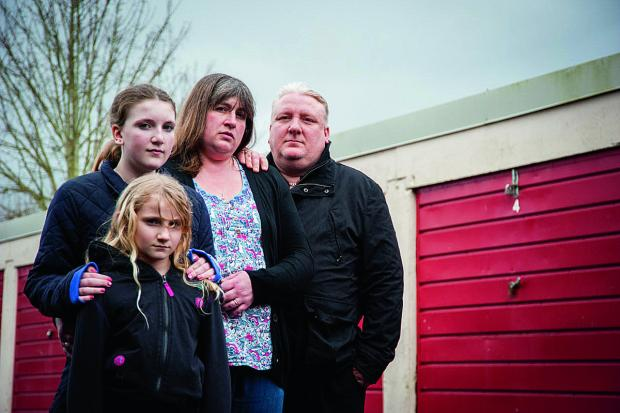 Darran Brown, with, from left, daughters Ellie and Laura and wife Julie, says Sanctuary Housing is incompetent, after claims it allowed his belongings to be binned