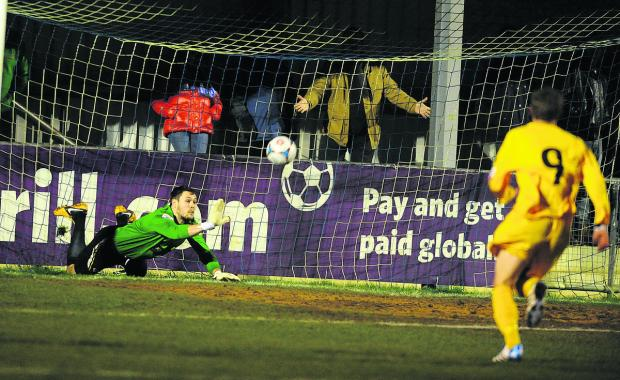 Oxford City keeper Mark Scott slips over allowing Barrow to grab a winner earlier this month