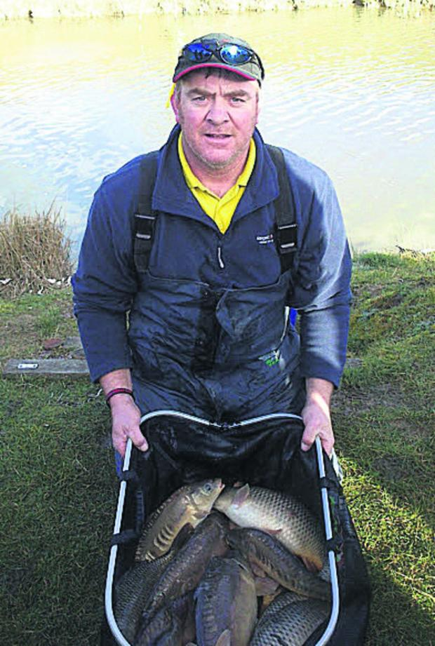 The Oxford Times: Littlemore's Mark Shepherd with his bag of carp from Panshill