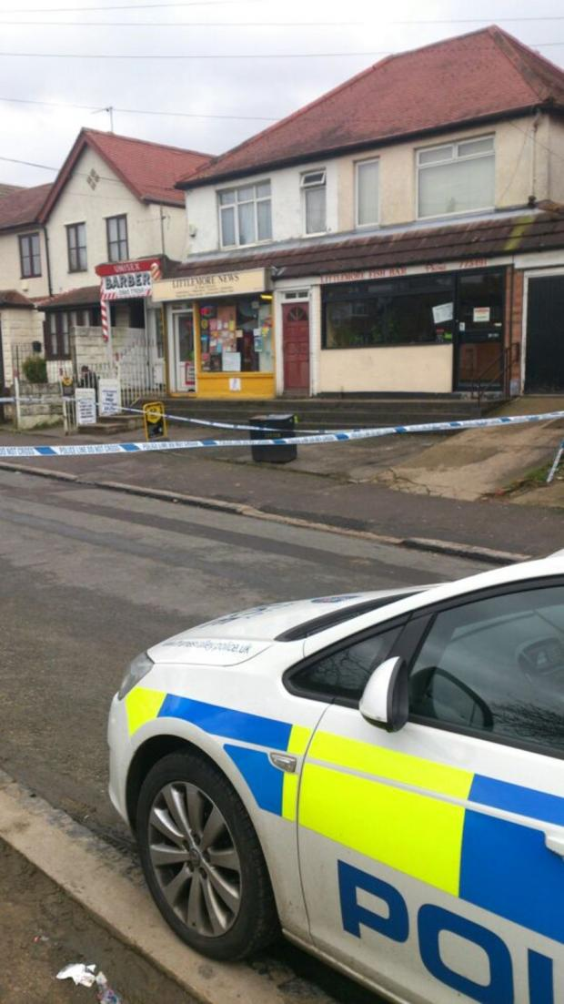 The Oxford Times: Police at the scene of a robbery of a Littlemore newsagents