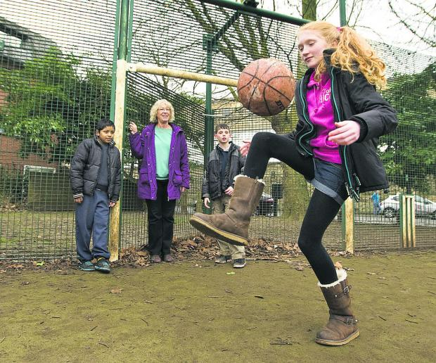 Zoe Crown, 12, shows off her football skills watched by Yahya Ashraf, 10, city councillor Susanna Pressel and Alex Crown, 10. Picture: OX65433 Antony Moore