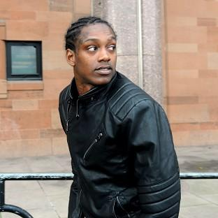 Swindon Town striker Nile Ranger is facing trial on a rape charge at Newcastle Crown Court