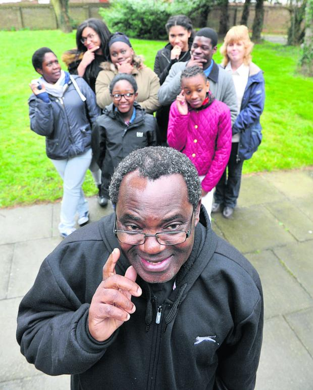 The Oxford Times: Father Nazariuz Mgungwe with some of the young people taking part in the Christian Youth Quiz Picture: OX65526 Denis Kennedy