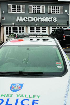 Police at McDonald's in Botley Road, which was targeted by robbers yesterday