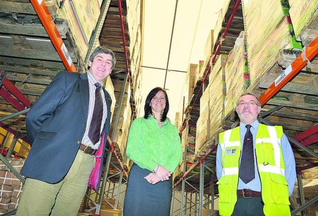 The Oxford Times: In the new £2.5m warehouse at EP Barrus in Bicester are, left to right, Robert Muir, managing director, Keryn Clarke, director of operations, and Bob Troup, warehouse manager. Picture: OX65544 Simon Williams