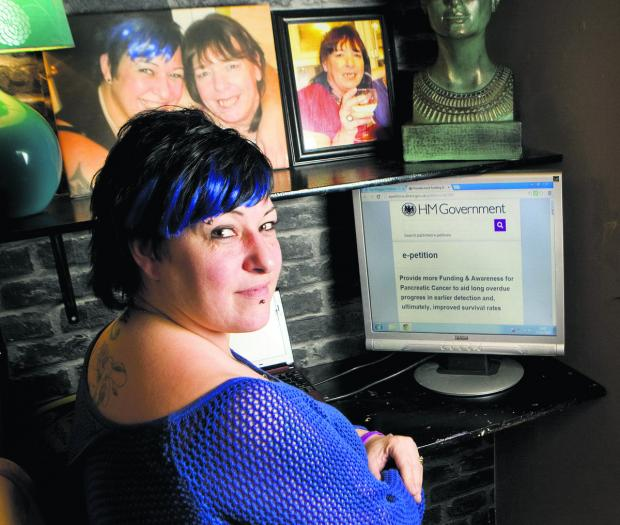 The Oxford Times: Kelley Spacey with the online petition calling for improved funding for research into pancreatic cancer. Her mother Janet is in photographs behind