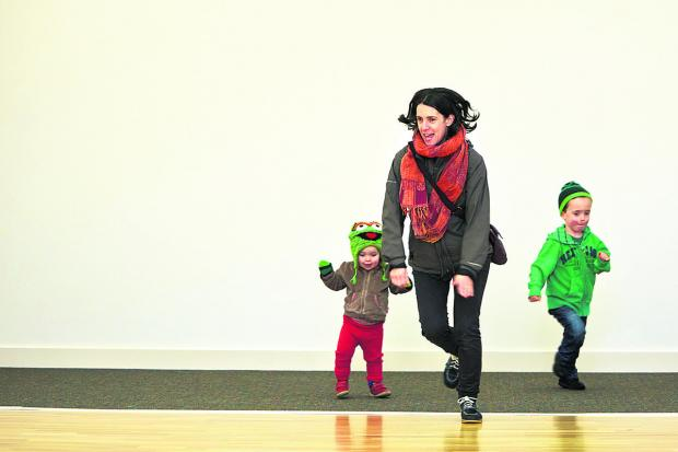 The Oxford Times: Isla Sharland, two, left, and Ben Sharland, four, right, and their mum Naomi Sharland enjoy being the first people to play in the new centre and