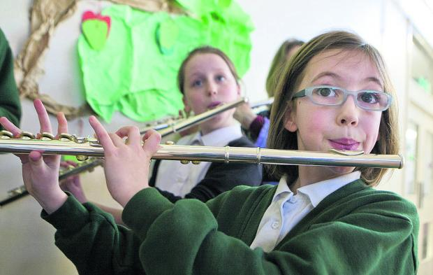 Megan Rees, 10, plays the flute in the new wind band at St Swithin's School, Kennington    Picture: OX65597 Antony Moore