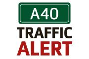 Car fire and oil spillage closes A40 westbound near Ducklington