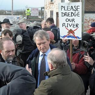 Environment Secretary Owen Paterson (centre) visiting Northmoor Pumping Station, Somerset, in January