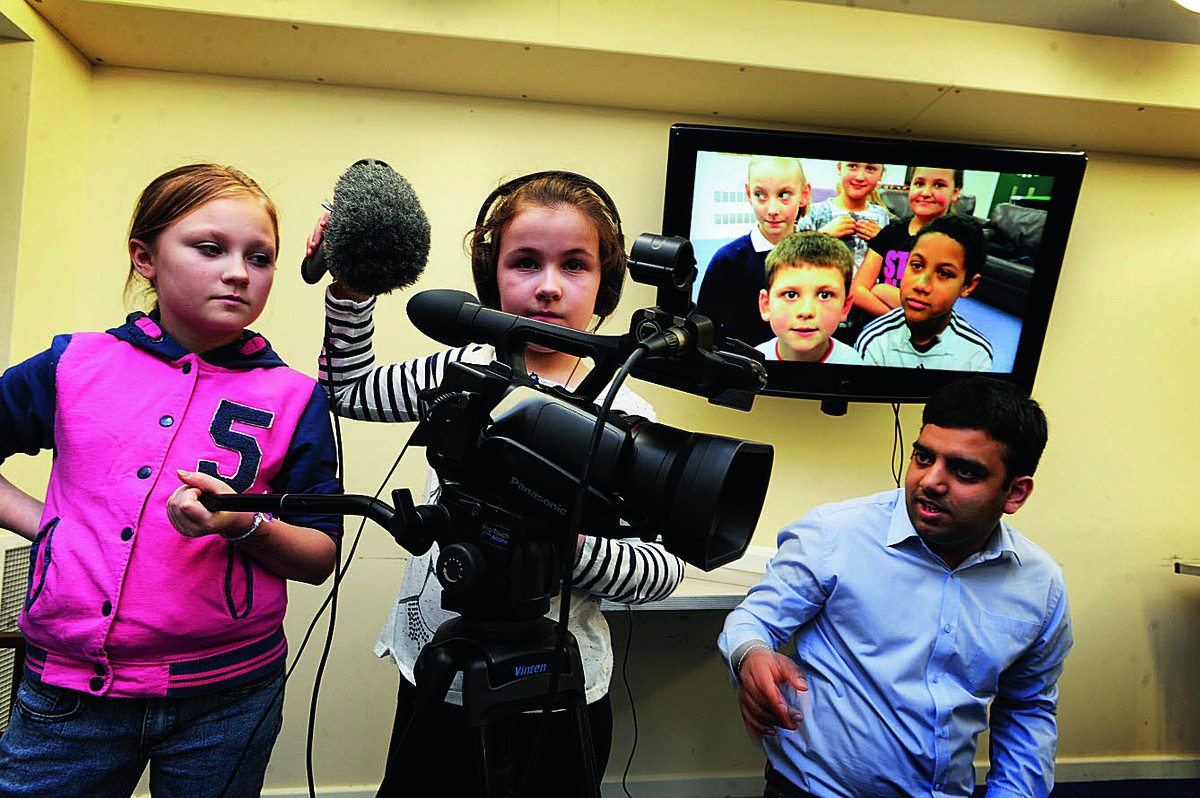 On the camera and sound here, from left, are Kirsty Gifford, 10, and Lily Matth