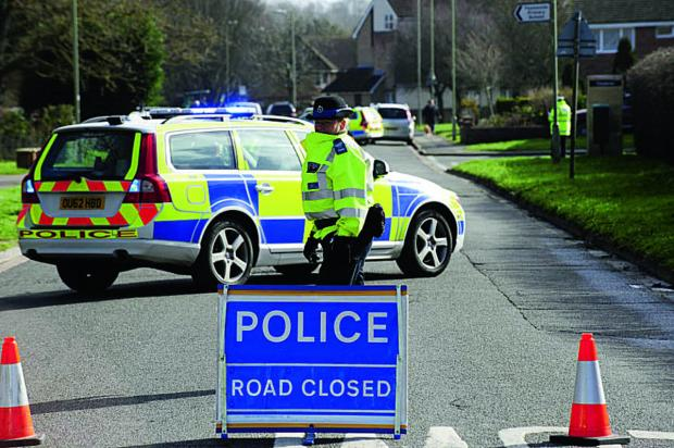 The Oxford Times: Police shut off the area at the junction of Kensington Close and Preston Road after the accident.