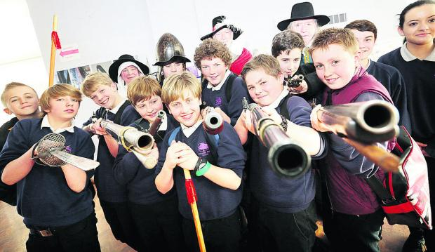 Wheatley Park School Year Eight pupils pose with 17th-century weapons. Pictures: OX65715  Damian Halliwell