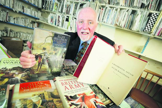 The Oxford Times: Thame Oxfam manager Dick Jennens with books by the historian and novelist Allan Mallinson Picture: OX65767 Damian Halliwell