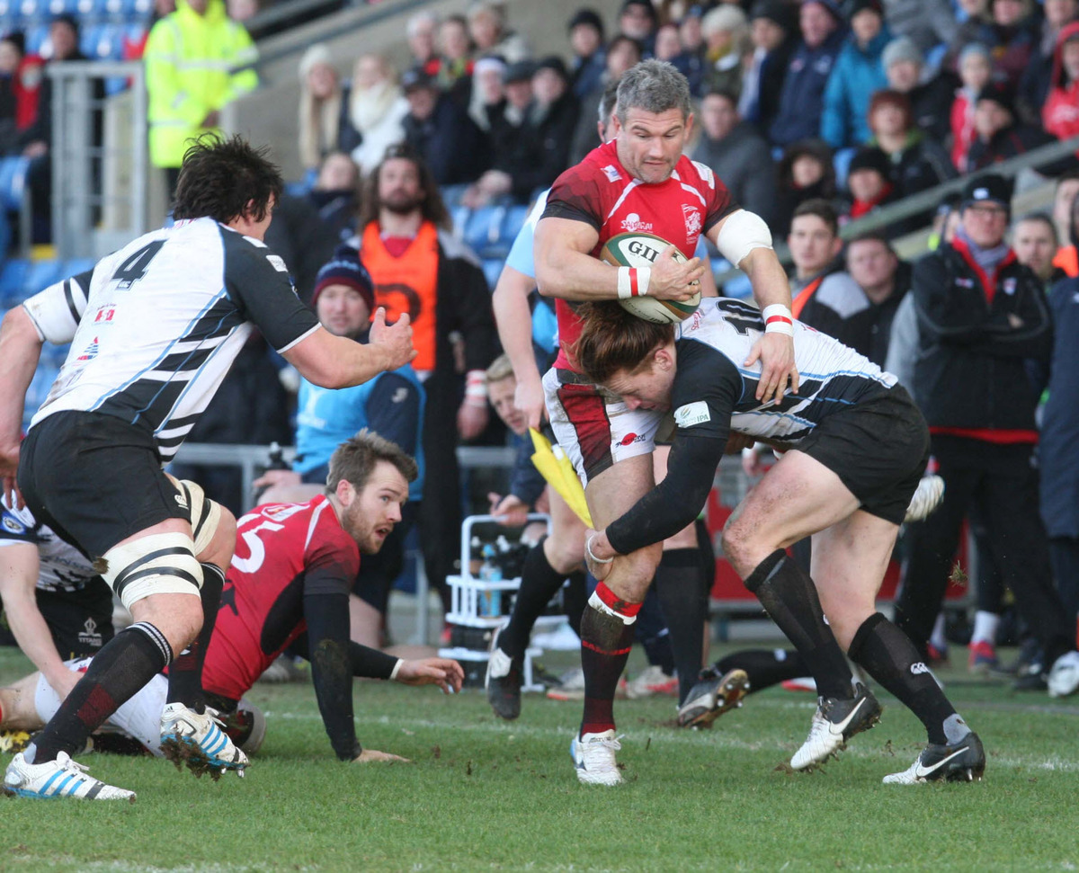 London Welsh captain Tom May is tackled during their victory over Rotherham at the Kassam Stadium. He leads his side out against Moseley at Old Deer Park tomorrow