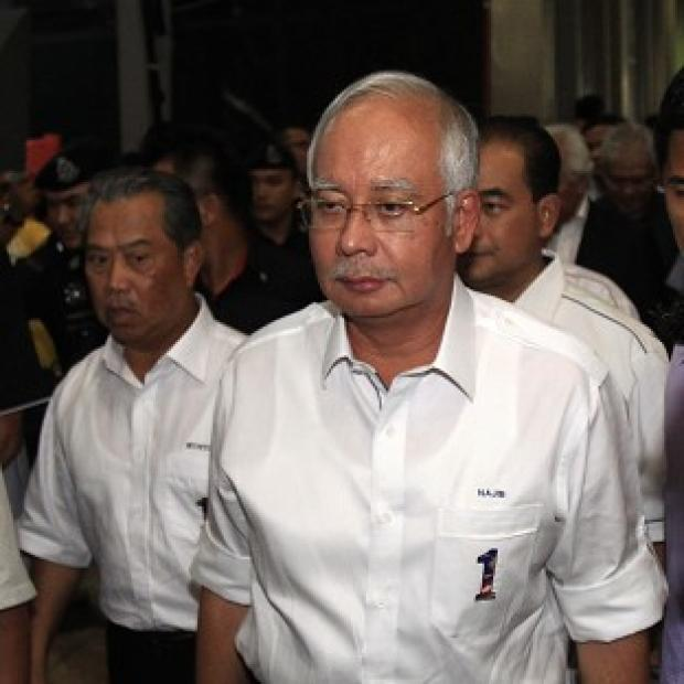 The Oxford Times: William Hague has offered UK help to Malaysian PM Najib Razak and authorities investigating a missing flight. (AP Photo/Lai Seng Sin)