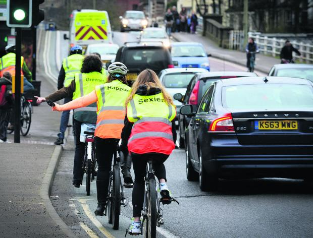 Members of Low Carbon West Oxford cycle down Botley Road in Friday's morning rush hour