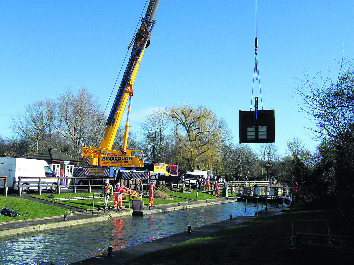 EASY DOES IT: New lock gates are fitted into position at Culham Lock
