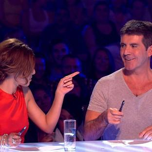 Cheryl Cole has signed a deal to return as a judge on the new series of The X Factor for a reported �1.5 million