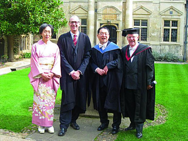 The Oxford Times: MILESTONE DAY: Kentaro Ikeda and mum Reiko in the gardens of St Edmund Hall, with the Principal, Professor Keith Gull, and the Senior Dean Professor David Phillips