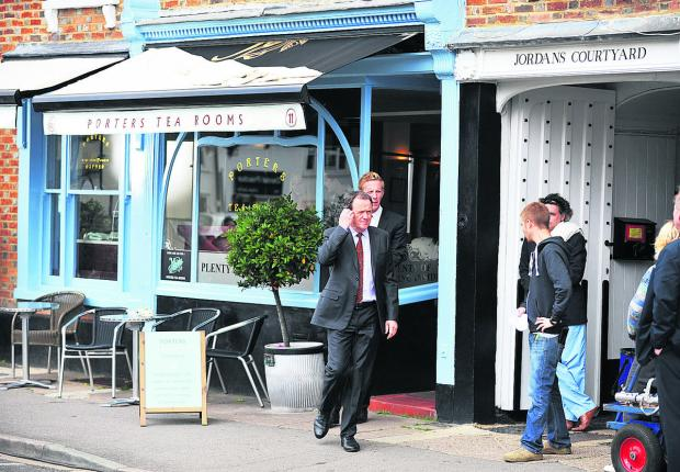 The Oxford Times: Kevin Whately and Laurence Fox filming a scene for Lewis in 2012 at Rumsey's Chocolaterie in Thame, which became Porters Tea Rooms for the occasion.  Picture: OX53883 Jon Lewis