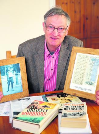 Colin Carritt with a picture of his father Noel and, right, a letter his father wrote on a cheque to his parents informing them of his plans                Picture: OX65936 Damian Halliwell