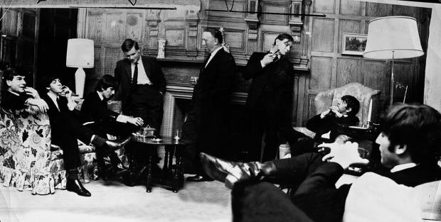 From left, students Jeffrey Archer and Michael Lloyd, Principal Sir Noel Hall and tutor David Stockton entertain Paul, George, Ringo and John in the principal's lodgings at Brasenose College when The Beatles visited in 1964