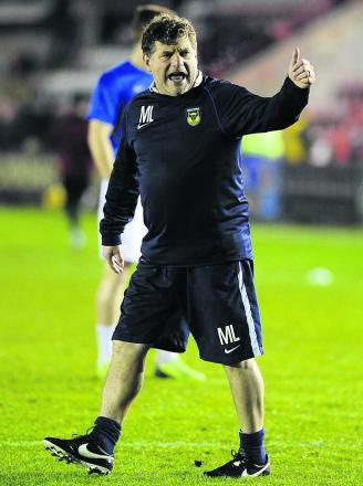 Mickey Lewis has kept the mood positive in Oxford United's camp