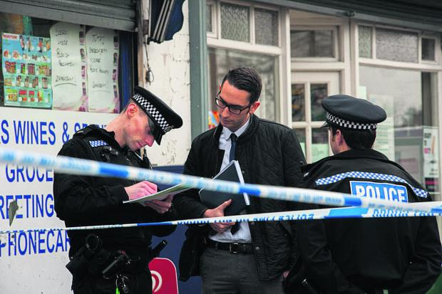 The Oxford Times: Police at the scene of the crime at Stan James bookies   Picture: Greg Blatchford