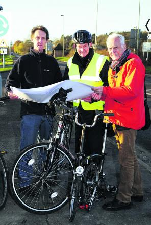 Bike Safe chairman Ian Leggett looks at plans for the cycle path with John Griffin and Graham Smith                           Pictures: OX63950 David Fleming