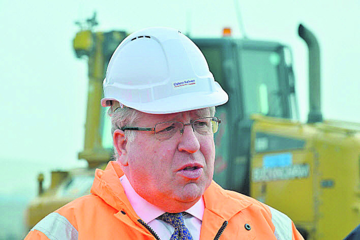 Transport Secretary Patrick McLoughlin during his visit to the rail link site