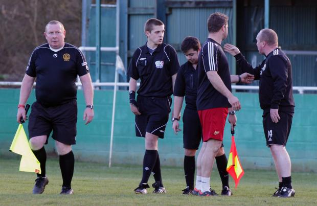 The Oxford Times: AFC Hinksey manager Kevin McMahon (right) verbally attacks referee Craig Boyles (second left) at the final whistle before being red-carded for foul and abusive language