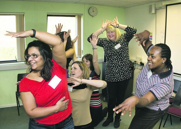 Debbie Illahi and Bernadette Birungi, front, lead a drama exercise     Pictures: OX65951 Antony Moore