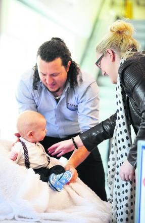 Photographer Ross Jennings, left, of Fraser Portraits, organises Alfie Cassels with his mother Kate Cassels
