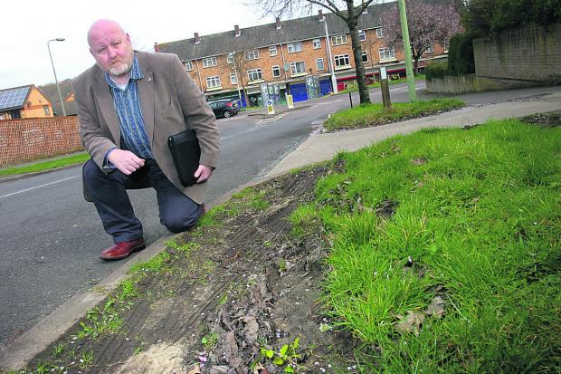 Van Coulter in Burchester Avenue, with some of the damage Picture: OX66064 Lucy Ford