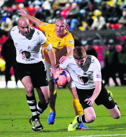 James Constable takes on two Gateshead defenders during the tough 1-0 win in the FA Cup earlier this season